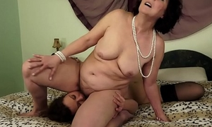 Of age lesbian rimmed apart from a luring youthful gal